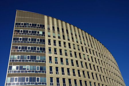 den: A modern Office building with a beautifull curve in Den Bosch in the Netherlands.