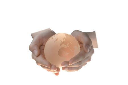 A crystal globe in a childs hands with highkey light from beneath. A symbol for the fragility of the Earth and its environment. Isolated against a white background.