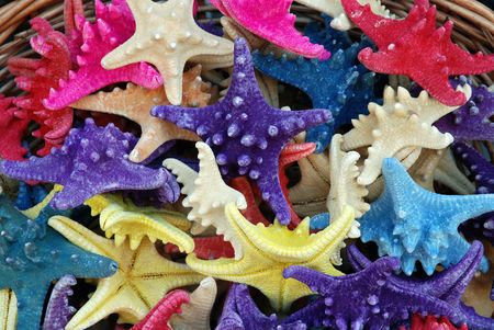 A basket filled with colorfull starfish on the beautiful isle of Crete (Greece)