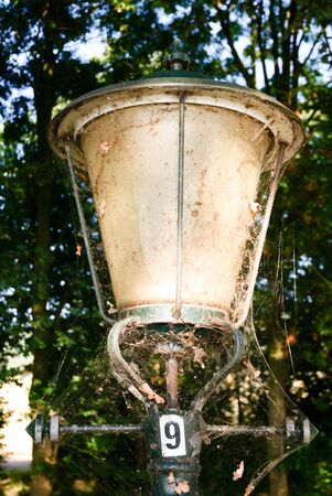 A close up of a dusty old lamp