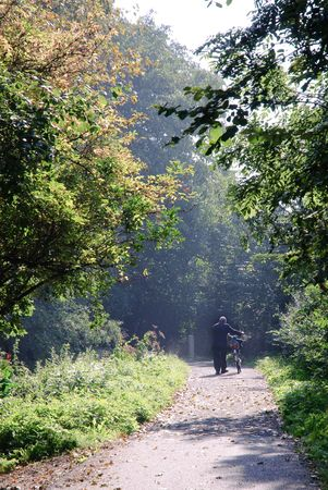 A lonely man walking in the sunlight. Stock Photo