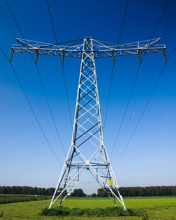 Steel towers supporting high voltage power lines.