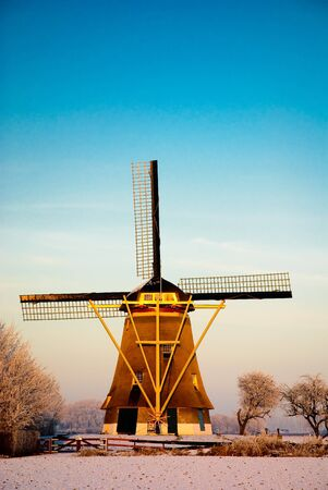 maintained: A well maintained windmill in the snow. A few minutes before sunset.