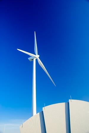 Wind turbine against a blue winter sky. Stock Photo