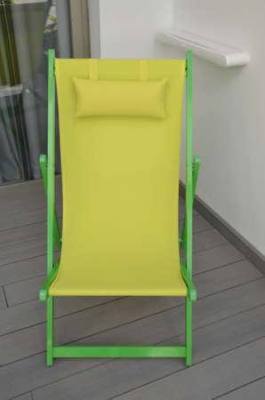 deckchair: Yellow deckchair Stock Photo