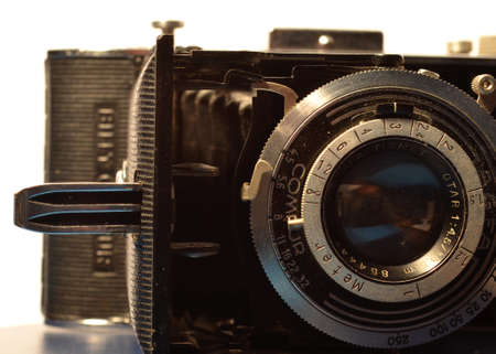 analogous: old fashioned camera lens in detail