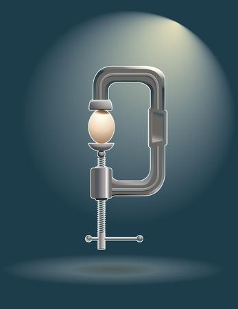 spot lit: A clamp holding an egg.