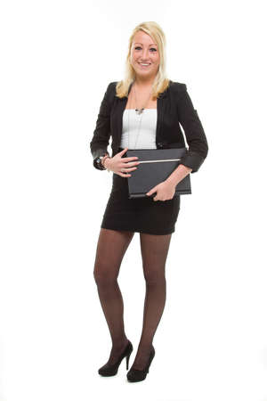 Pretty smiling business woman, with portfolio in het hand Stock Photo - 12990872