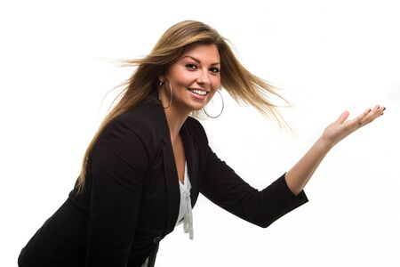 Young smiling brunette lady showing your product photo