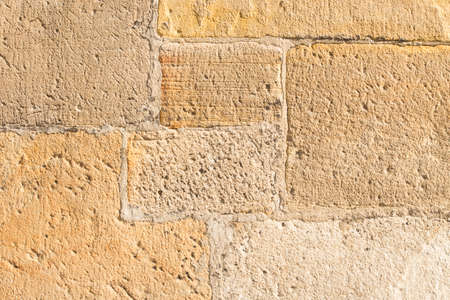 very old sandstone wall worked by a stonemason Stock Photo