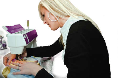 Woman seamstress work on the sewing-machine photo