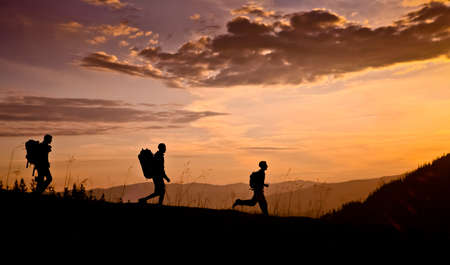 ecotourism: hikers on sunset