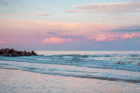 pink sunset on the evening beach