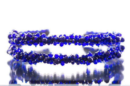 stones of blue color on the rim for the head of white backgraund