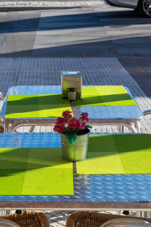 Flowers on a cafe. Table in the cafeteria. Terrace