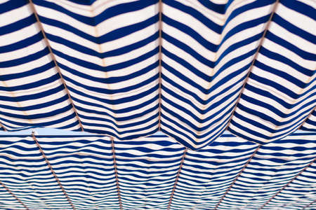 White and blue awning. Striped canvas. Background. Standard-Bild
