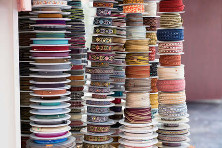 Grosgrain and another type of ribbons in a haberdashery. Colorful scene. Stockfoto