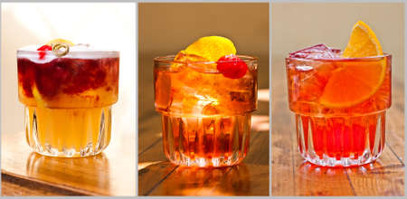 Beautiful classic cocktails. New York Sour, Negroni, Martinez. Wood background.