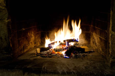Chimney place. Flames of fire in a fireplace. Realistic fire.