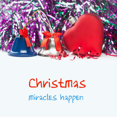 silver bells: Bright christmas composition with red toy heart and bells (with easy removable sample text). White isolated background. Blue and silver bells. Stock Photo