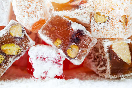 powdered: Tasty oriental sweets (Turkish delight lokum) with powdered sugar. Stock Photo