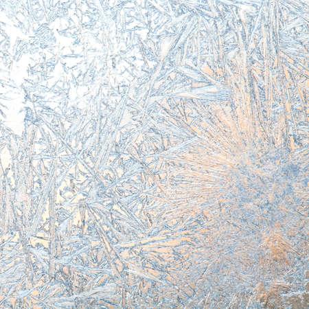 ice texture: Frozen glass. Ice flowers. Frost flowers. Window frost. Winter in the window. Frozen window. Macro. Soft focus. Stock Photo