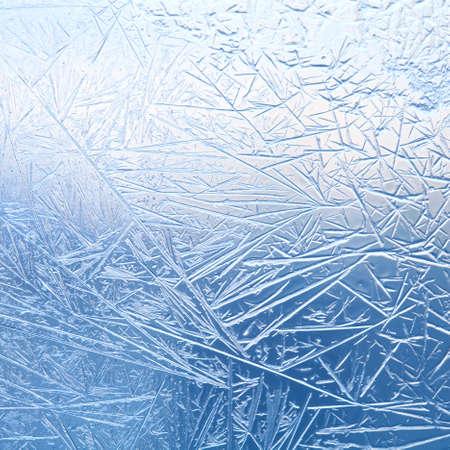 Frozen glass. Ice flowers. Frost flowers. Window frost. Winter in the window. Frozen window. Macro. Soft focus. Standard-Bild