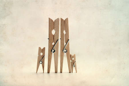congeniality: Family. Abstract: The family of linen clothespins. Man, woman with children. Vintage paper background.  Soft focus.