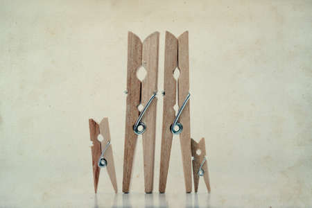 Family. Abstract: The family of linen clothespins. Man, woman with children. Vintage paper background.  Soft focus.