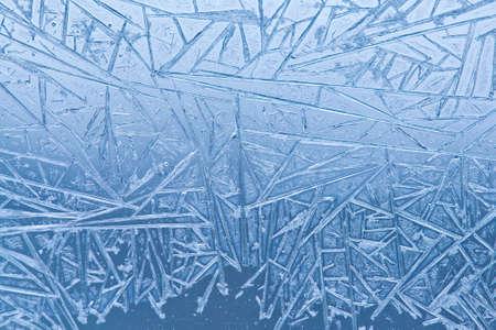 craquelure: Frozen glass. Ice flowers. Frost flowers. Window frost. Winter window. Frozen window. Craquelure. (Macro. Soft focus. Toned photo).