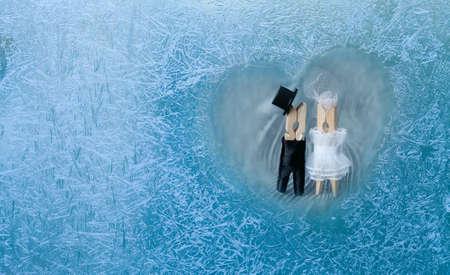 craquelure: Romantic couple. Man, woman in frozen heart. Groom and bride. Frozen glass. Ice flowers. Valentines day. Window frost.  Frozen window. Craquelure. (Macro. Soft focus. Toned photo).