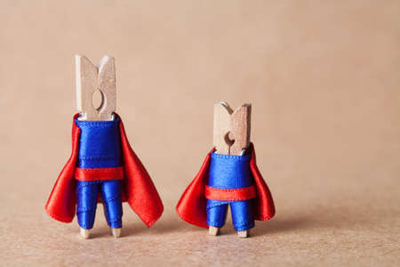 powerful creativity: Clothespins. superheroes in blue suit and red cape. Confident clothespins. (retro style, soft focus)