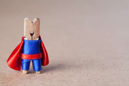 Clothespin. superhero in blue suit and red cape. Confident clothespin. (retro style, soft focus) Reklamní fotografie