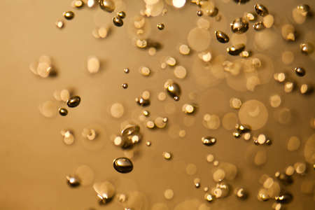 Water with bubbles. gold, golden background. abstraction. (soft focus, toned photo) Stock Photo