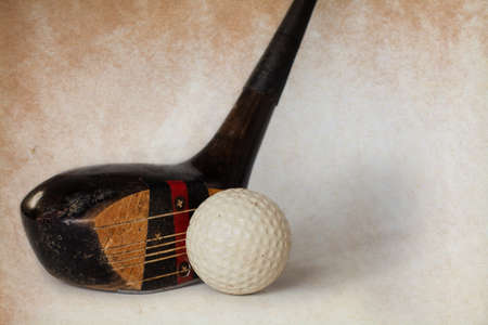 putter: Vintage, antique golf driver (putter). golf club. retro paper background. Stock Photo