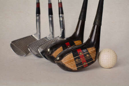 Vintage, antique golf driver (putter). golf club. retro paper background. Stock Photo