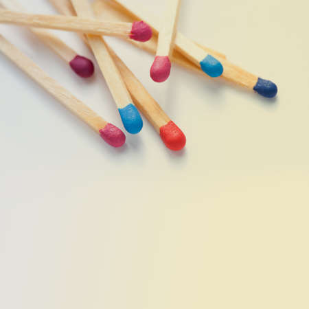 Wooden multicolored matches. Retro colors background. Macro view, toned photo photo
