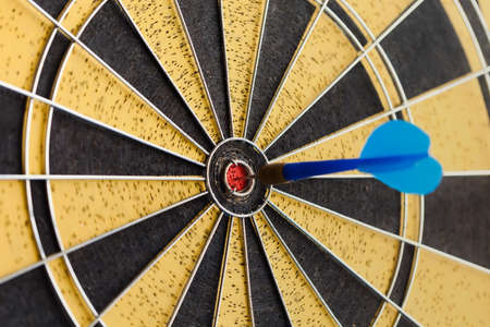 focus on: Success hitting target aim goal achievement. Retro darts aim. soft focus, toned photo Stock Photo