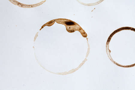 cruddy: stain circles in brown. paper texture background
