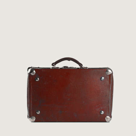 poky: Old-fashioned brown travellers bag