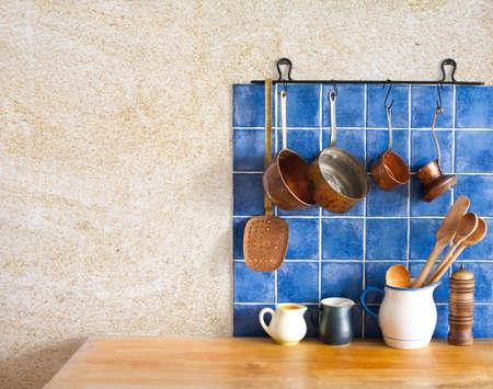 bakelite: kitchenware set.  Blue tiles, aged sand wall texture.