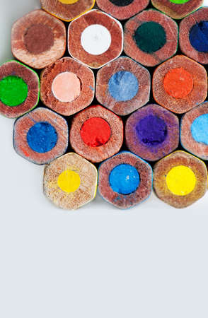 garish: Colorful wooden pencils. Green, blue, red, white, orange, violet, marine, green, yellow. Macro view, soft focus. Textured. Copy space