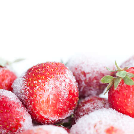 Cold concept. Frozen Strawberry. red fruit berries with a ice crystal surface, snowflakes. Closeup. copy space. white background. Shallow depth of field.
