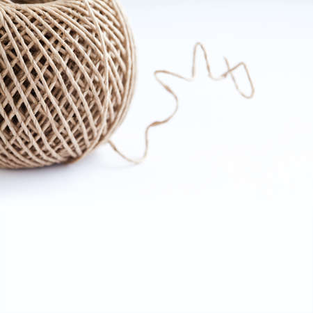 coiled rope: Roll of paper craft rope on white background. copy space. Closeup, soft focus