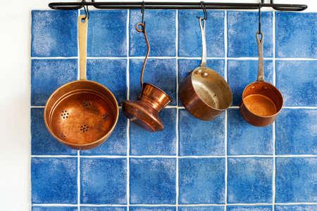 cooking utensils: Pots, colander, coffee turk. front view. Stock Photo