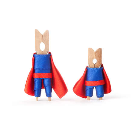 powerful creativity: Superheroes clothespins in blue, red suits. Big boss and small worker on White background