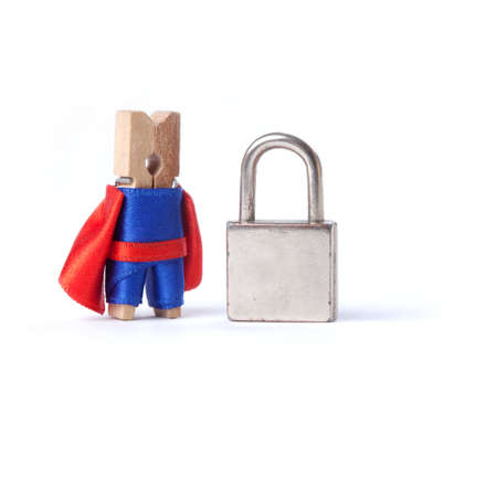safeguard: Safeguard clothespin superhero in blue, red suit and metal lock on white background. Stock Photo