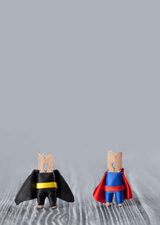powerful creativity: Super hero clothespin in blue, red and black, yellow suit on gray background.