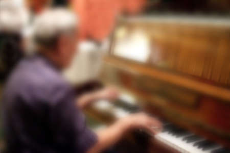 pianist: Abstract blurred pianist.