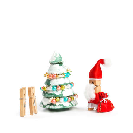 suddenness: Wooden clothespin Santa Claus with bag gift, kids and decorated christmas tree. Stock Photo